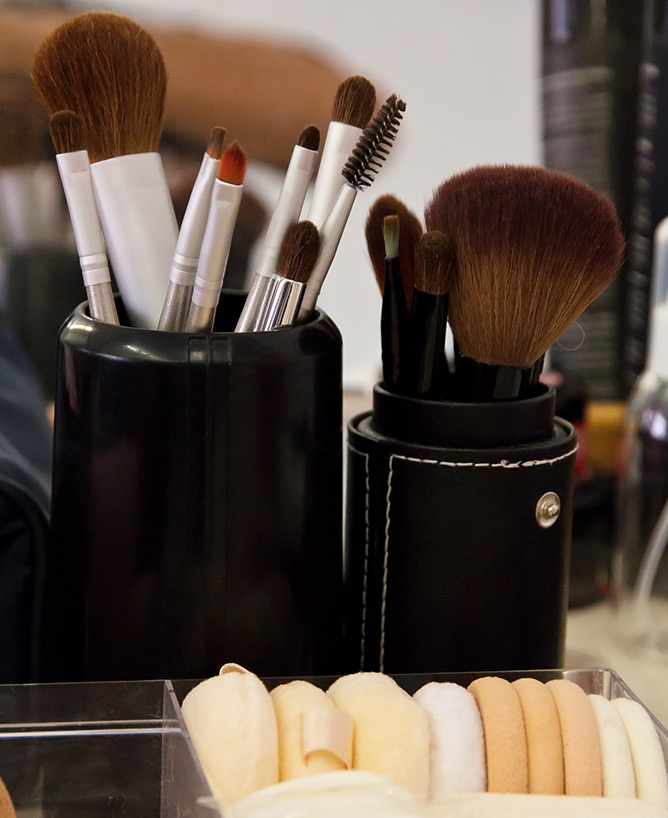 A collection of makeup brushes and sponges used at The Iver Academy