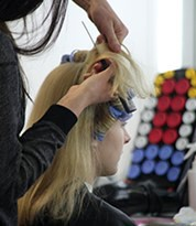 Hair artist applying character hair during a training course at Iver Academy